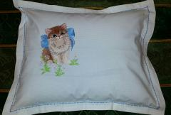 Embroidered pillow with kitty and bow design