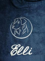 Embroidered towel with head of dog design