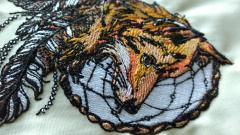 Fragment of fox and dreamcatcher embroidery design
