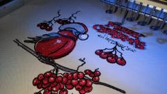 Making red bullfinch embroidery design