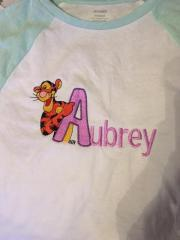 Summer baby outgit with embroidered free Tigger design and Aubrey name