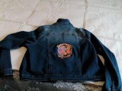 Embroidered jacket with flower skull design