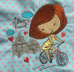 Girl on bicycle embroidery design