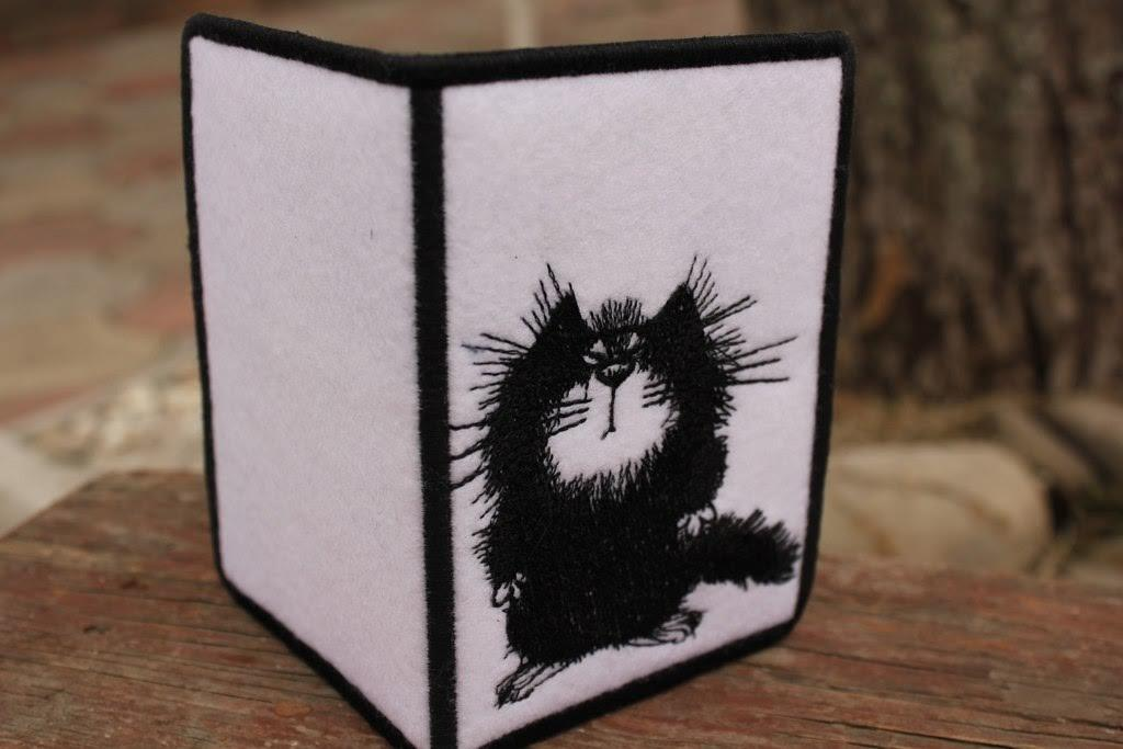 Embroidered cover with fluffy cat free design