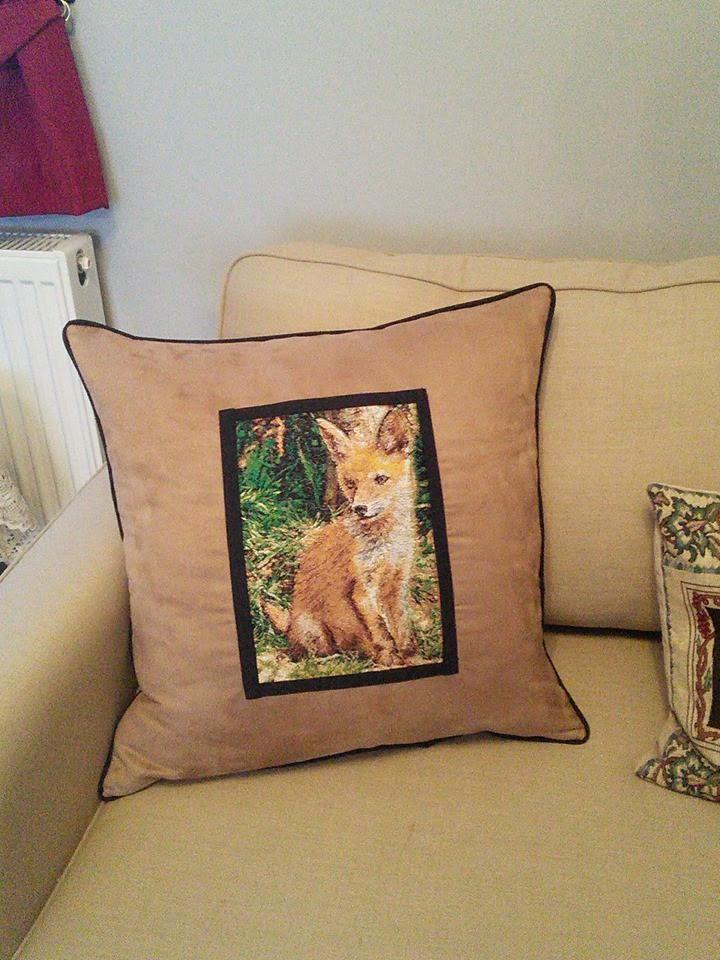 Embroidered cushion with little fox design