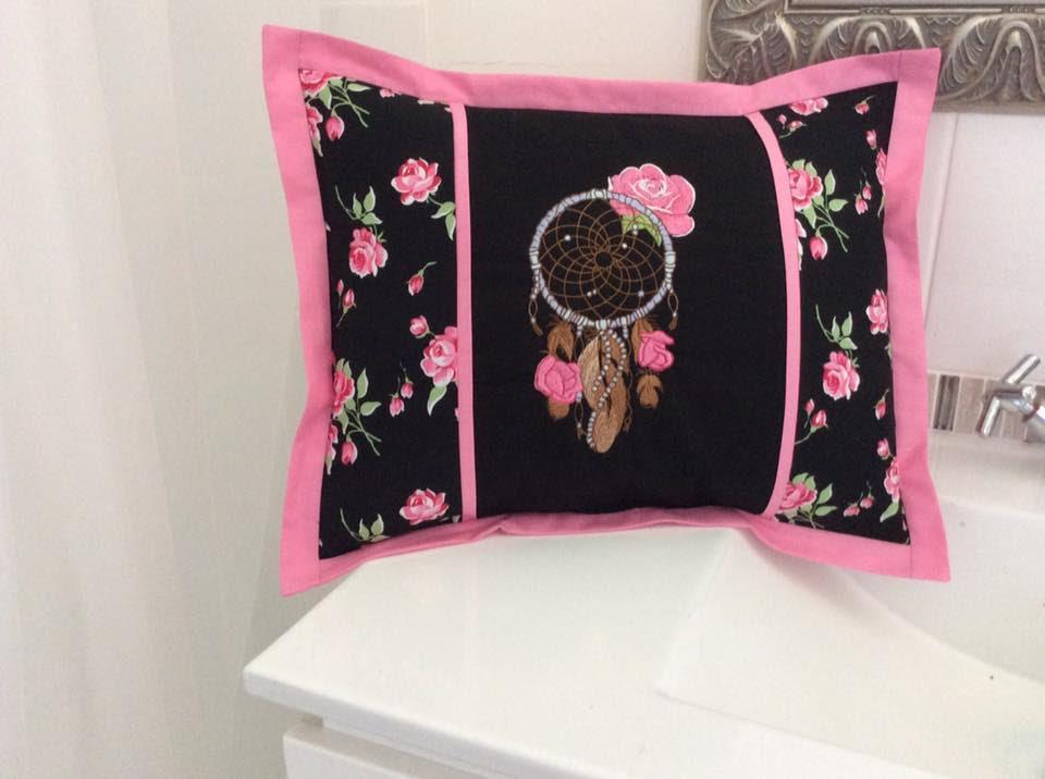 Embroidered cushion with romantic dreamcatcher design