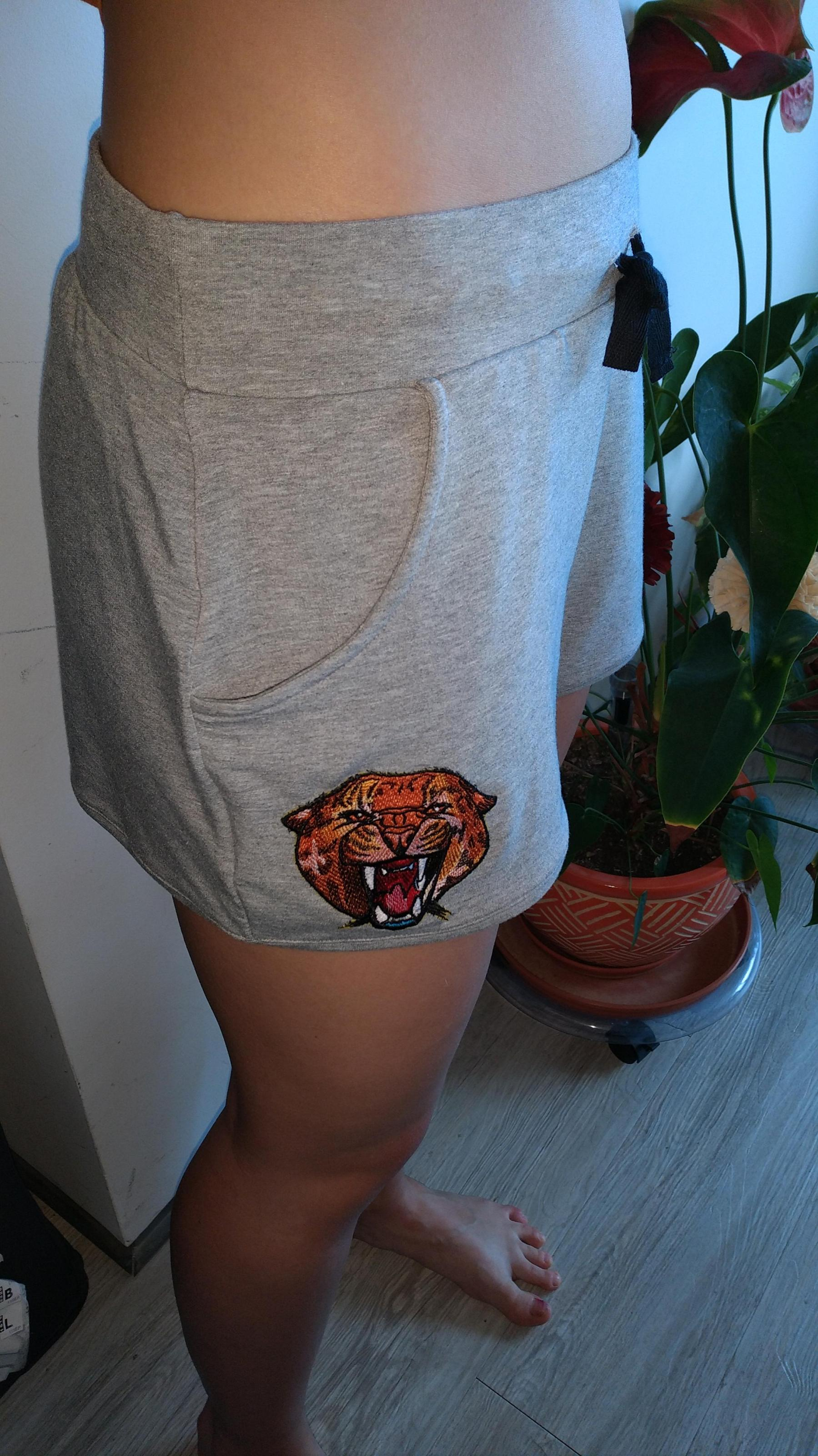 Embroidered shorts with Wild cheetah design