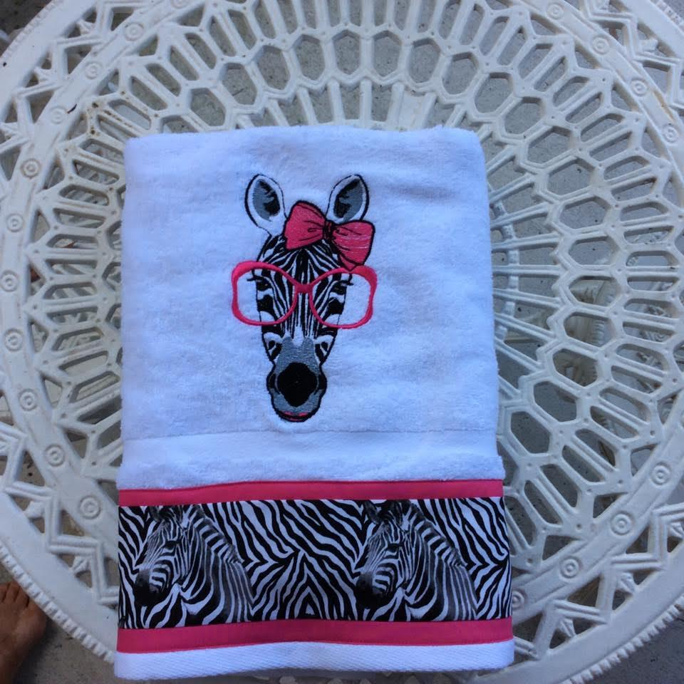 Embroidered towel with zebra in glasses free design