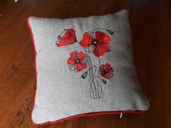 Poppie free embroidery design cushion