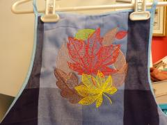 Embroidered apron with Autumn leaves design