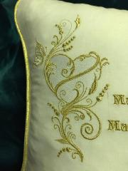 Embroidered cushion with golden heart design