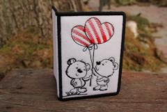 Embroidered document with cover bears and balloons design