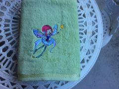 Embroidered towel with flying fairy design