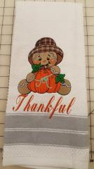 Embroidered towel gingerbread with pumpkin design