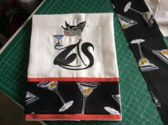 Embroidered towel with glamour cat design