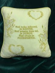 Embroidered white cushion with golden heart design