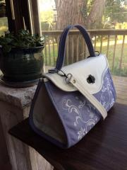 Embroidered woman bag with floral swirl free design