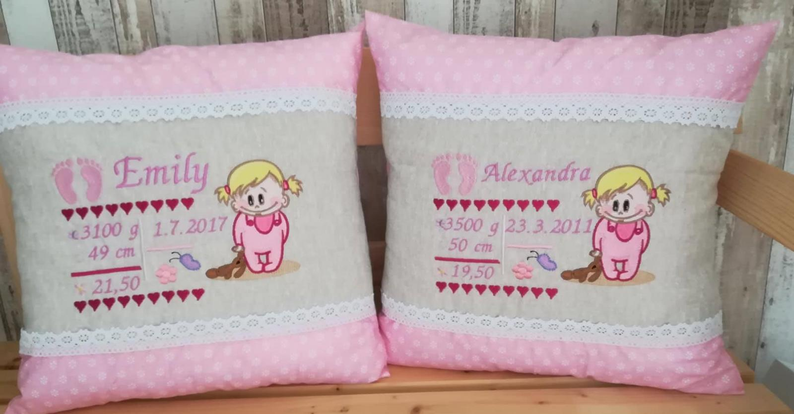 Two embroidered pillows with baby girls