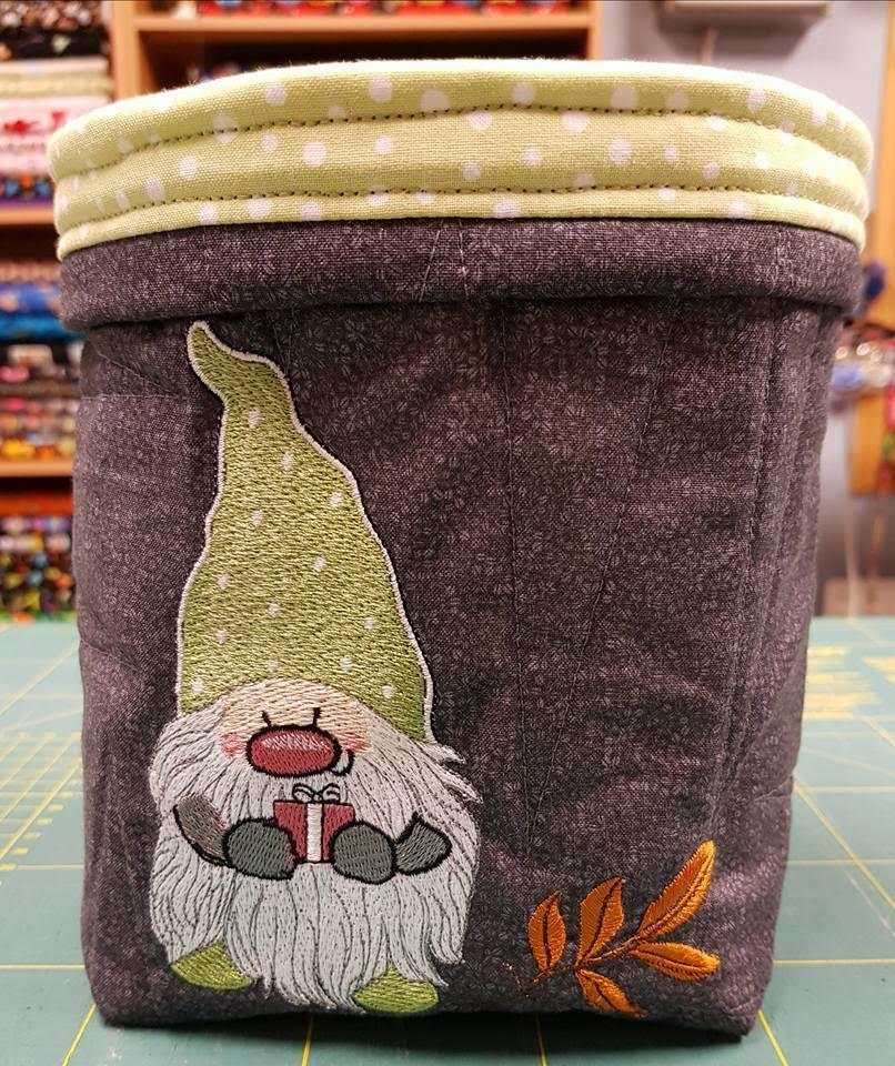 Embroidered basket with Christmas dwarf design