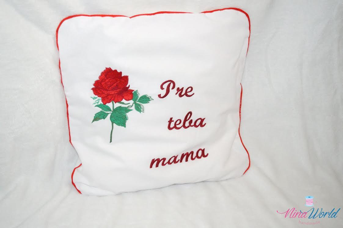 Embroidered cushion with red rose design