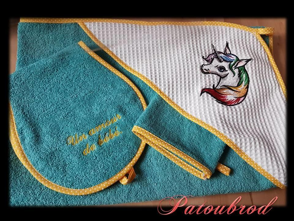 Embroidered newborn set with Colored unicorn design