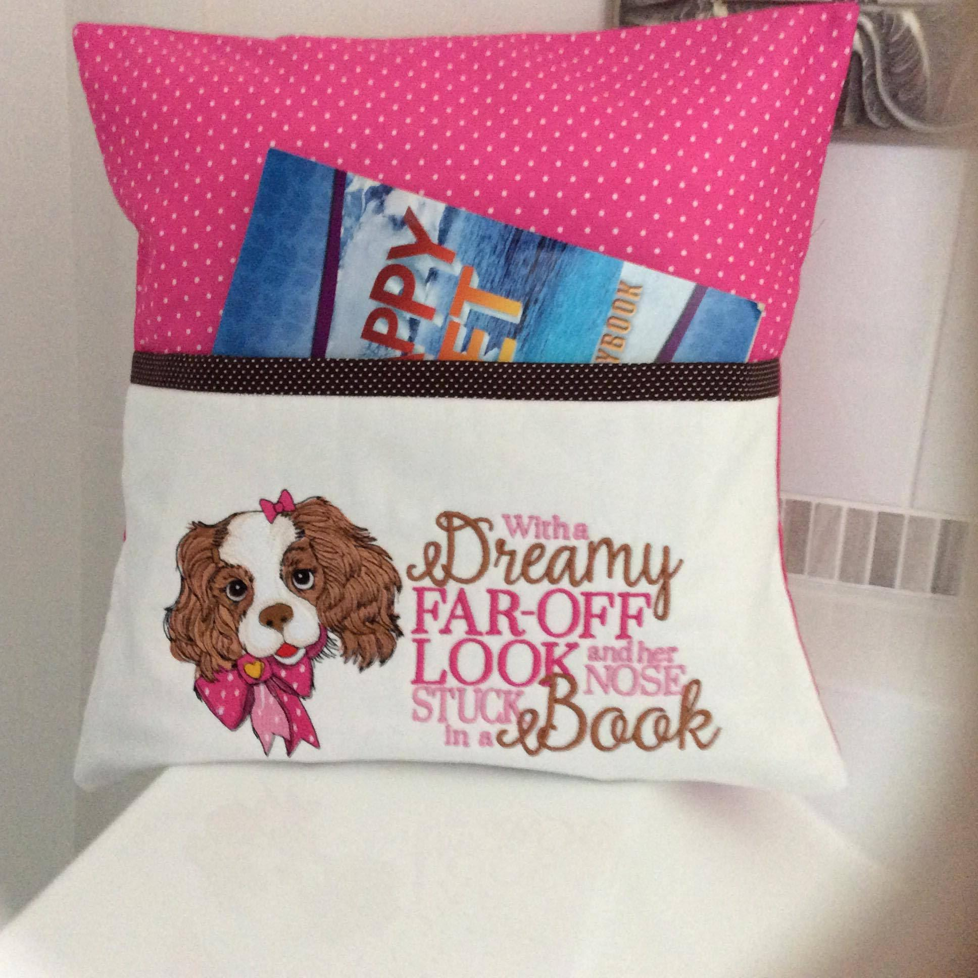 Embroidered pillow with spaniel puppy design