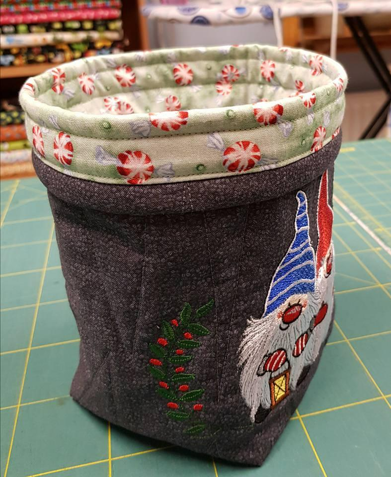 Embroidered textile box with Christmas dwarves design