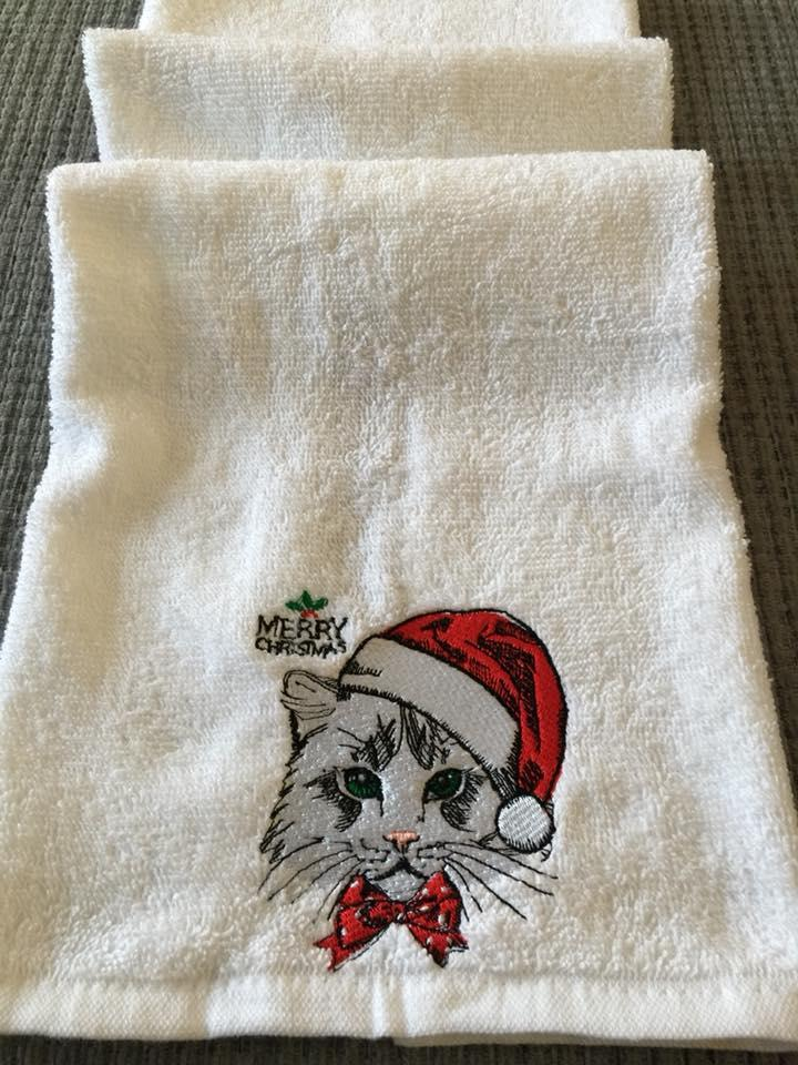 Embroidered towel with Christmas cat design