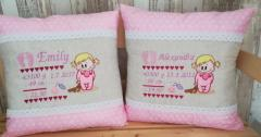 Two embroidered pillows with baby girls design
