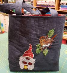 Embroidered bag with Christmas dwarf and winder bird designs