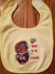 Embroidered bib with pilot hedgehog design