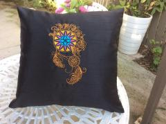 Embroidered cushion with Curvy dreamcatcher design