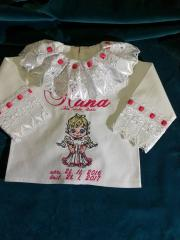 Embroidered baby girl dress with cute angel design