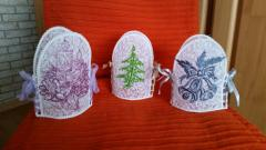 Embroidered knitted Christmas souvenirs with free designs