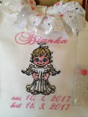Fragment of embroidered baby girl dress with little angel design
