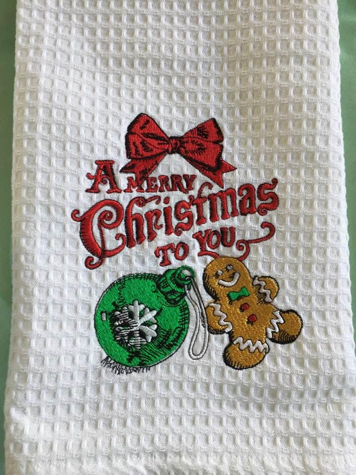 Embroidered towel with Christmas ball and gingerbread design