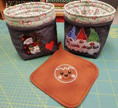 Embroidered Christmas baskets with snowman and dwarves designs