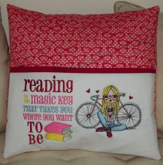 Embroidered cushion with young photographer design