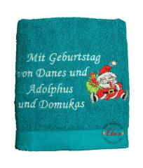 Embroidered towel with Santa near chimney design