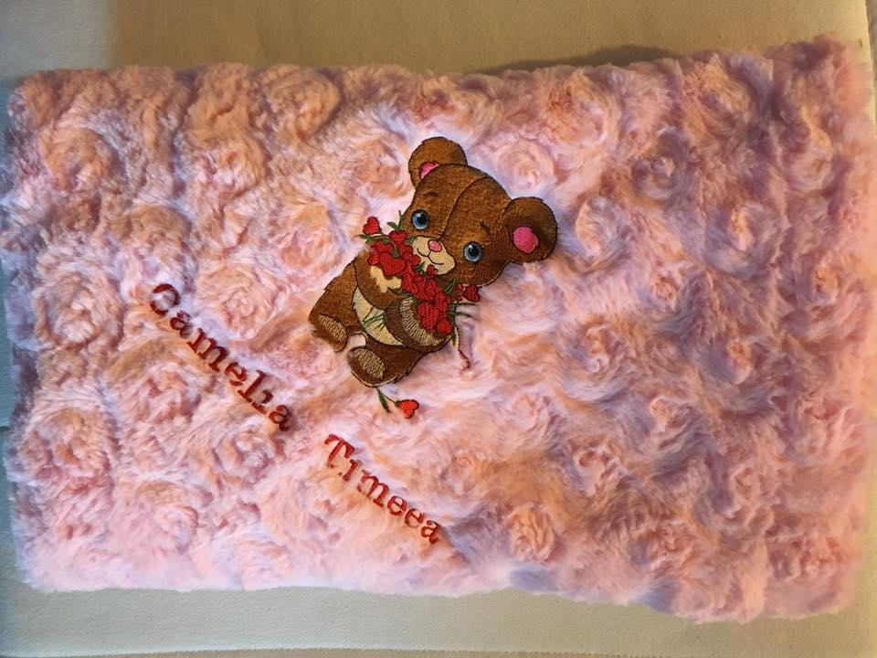 Embroidered baby item with Shy Teddy bear design