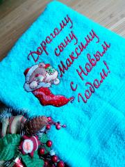Embroidered towel bear in Christmas sock design
