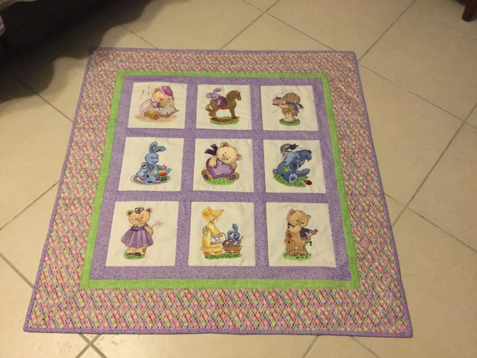 Embroidered quilt with old toys designs