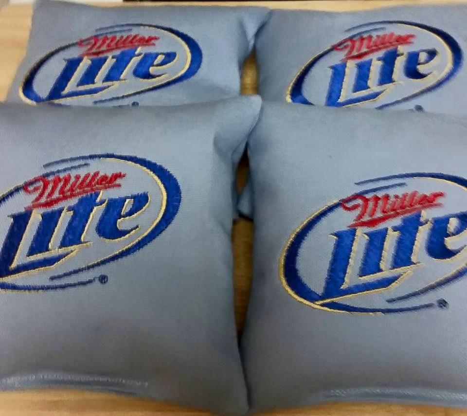Pillow with Miller lite logo embroidery design