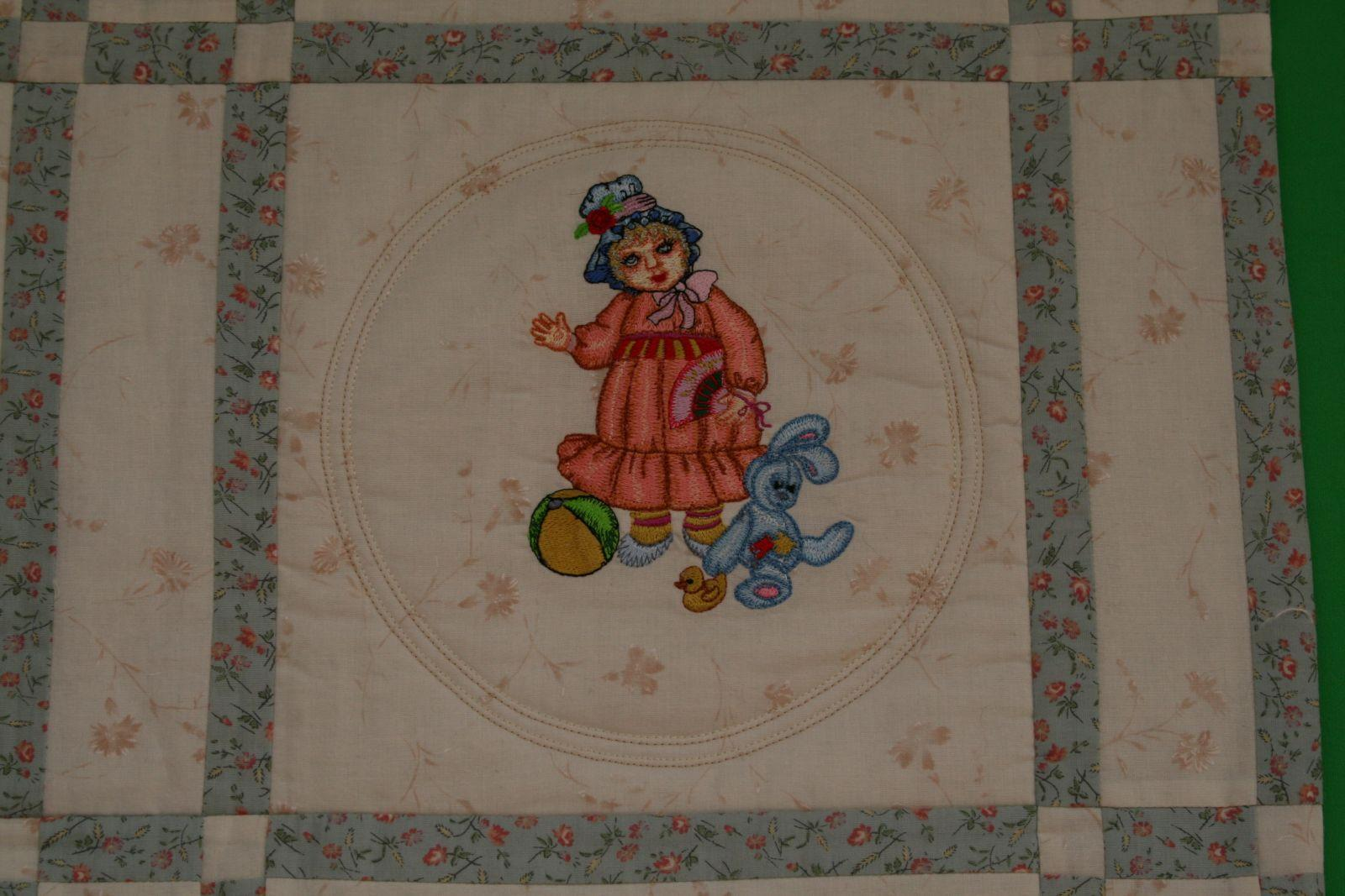 Doll with bunny toy embroidered design