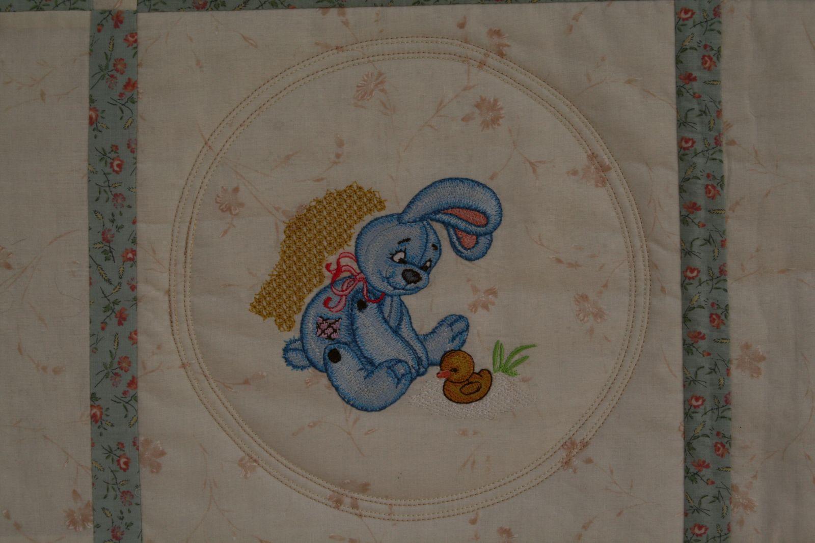Rabbit embroidered quilt