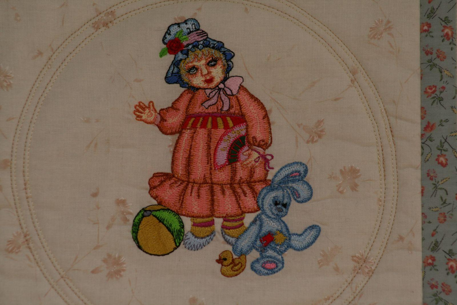 Doll with bunny embroidery design