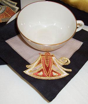Tea napkin with Egyptian embroidery design