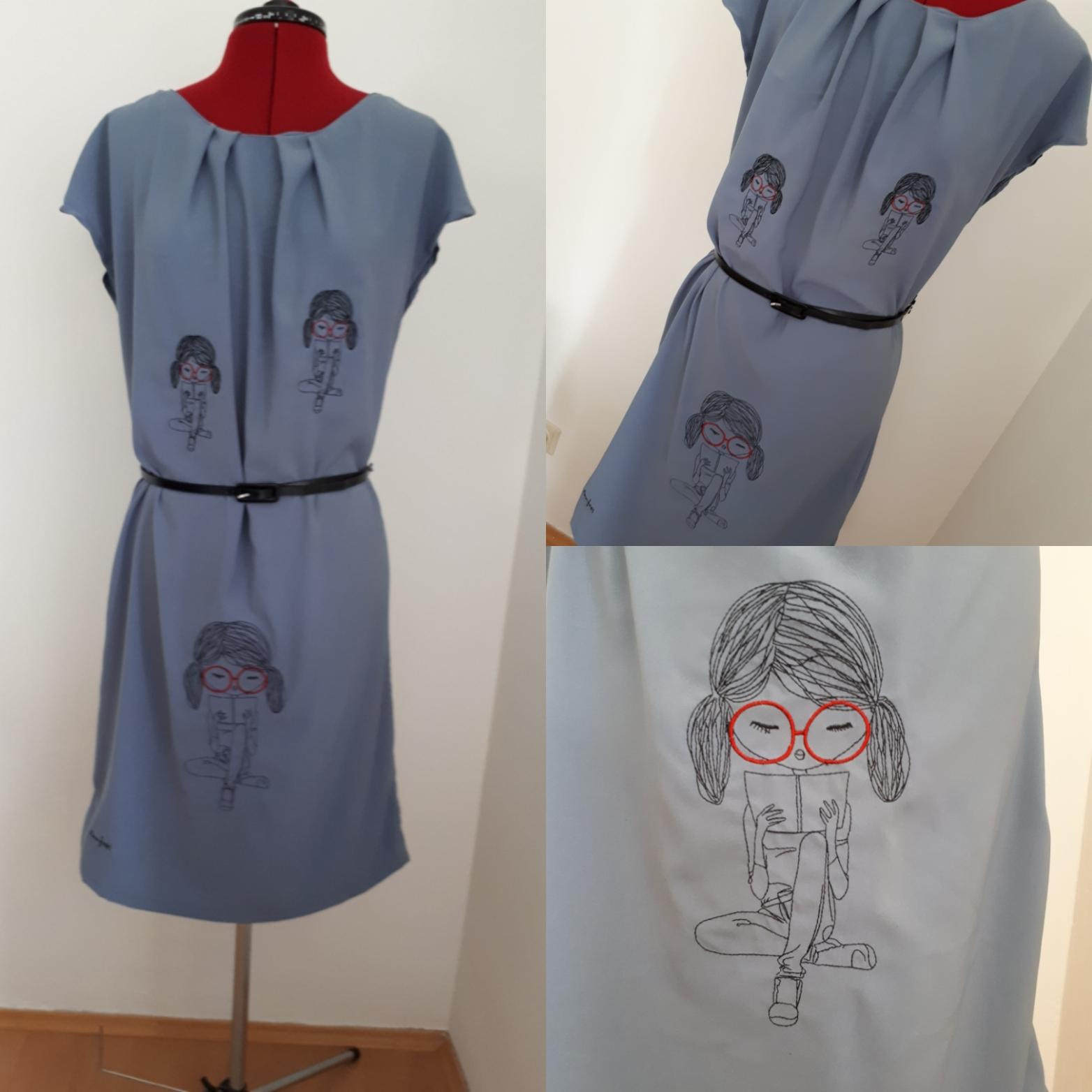 Embroidered dress with Reading girl design