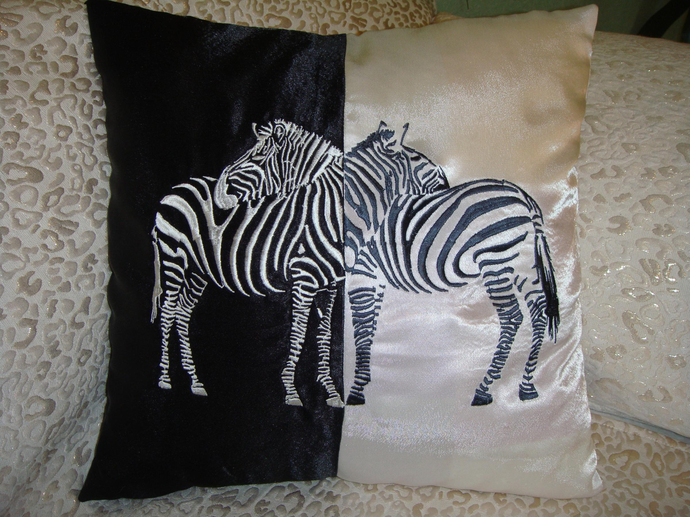 Pillow with two Zebra free embroidery design