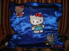 A pillow with Hello Kitty